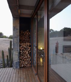 Love this idea for firewood storage. Look to incorporate into back door entrance of extension.