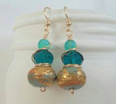 Check out this item in my Etsy shop https://www.etsy.com/listing/225365199/gold-and-blue-lampwork-beaded-earrings