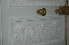 Architectural detailing, mouldings, and plaster reliefs at Petite Trianon. Could buy wallpaper panels, paint them, & put them on doors. Or just use crown moulding & paint it shabby chic.
