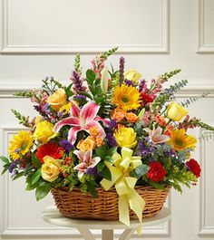 ROYAL BEAUTY Here is a Basket of Royal Beauty mix flowers, hand-crafted in a basket. You can make your order to get the flower arrangement delivered to your loved ones. The basket is arranged with 50 + mix flowers(include- Lilies, Carnations, Roses, Daisies and lush green fillers).