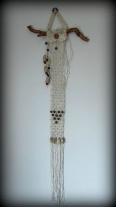 """Macrame wall hanging, by Linda Page of Bohemian Pages ~ hemp, lace, wooden beads, a metal washer, handmade polymer tube beads & a carved button, plus a tiny moonstone that has been charged under the moon. Hanging is 31"""" long & 2.5"""" wide.   $18.00, via Etsy"""