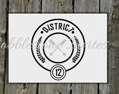 12 x District inspired table number cards for a Hunger Games themed wedding or birthday