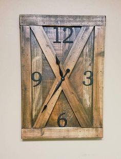 Reclaimed wood barn door farmhouse wall clock with distressed weathered finish and metal numerals. Fixer upper clock, rustic clock