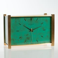 This Patek Philippe electronic quartz table clock was made 1974 in Switzerland. The casing of gilded brass and green lacquered parts, in imitation of jadeite, display a beautiful colour contrast.