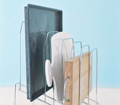 Use a Desk Organizer Sort cookie sheets, cutting boards, and jelly-roll pans in the kitchen for easy access (and no more cymbal-crashing sounds) in an overstuffed cabinet.