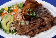 Carne Asada with maduros (sweet plantains), gallo pinto (beans & rice), avocado & salad. The Nicaraguense way