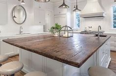 I'm kinda in love with this HUGE reclaimed wood island I found on Pinterest! (The image is from homedit.com, photography by Carl Mayfield Photography) I love how the kitchen still feels super light and airy, but that reclaimed top is so inviting to gather around.  This kitchen chose the perfect focal point.  #homedecor #kitchen #kitchendesign #reclaimedwood #kitchenisland #homeinspo #whitekitchen #farmstyle #cottagelife #betterhomesandgardens #countrylivingmag #simple #neutrals…