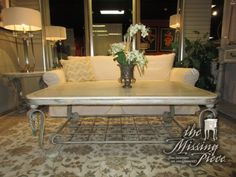 """Metal coffee table in a light finish with cream stone top and grid patterned shelf below. Love the rope trim around the edge of this coffee table. 55""""L x 38""""D x 21""""H. At posting, we have the matching end table."""