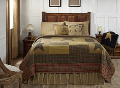Our Stratton King Quilt would make for the perfect bedroom redo. It comes in several sizes and features vintage colors and a simple quilted block pattern. https://www.primitivestarquiltshop.com/search?type=product&q=stratton+king+quilt #primitivecountrybedroomsbeddingandaccessories