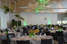 We love this unique installation due to our suspended greenery and custom-made geometrical shapes installed within our truss structure. Perfect coordinating colors for this special event designed by yours truly!