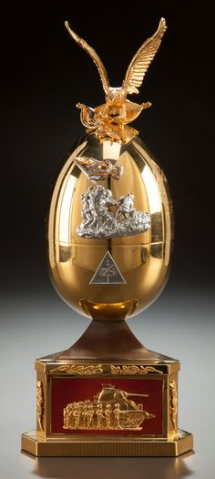 """(3)FABERGE eggs__Theo Faberge___""""Victory""""  final salute to his World War II comrades-in-arms pays homage to these heroes and their sacrifices in the most bloody conflict ever. Crafted from sterling silver, 24 karat gold and guilloche enamel, the egg is an elegant yet powerful depiction of the armed forces in the major theatres of the conflict."""