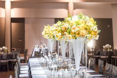 Yellow floral on white bell vases with hanging crystals. Centerpieces for estate table. Decor and floral by Southern Event Planners. Photo by 3eightphotography