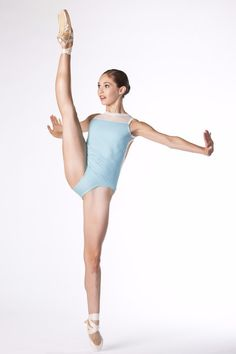 Monaco Leotard by Second Skin - A classic fitted leo bodysuit for dancers and ballerinas for class, convention, competition and ballet. Mesh on high neck top and open circle back in a light, sky blue with white accents, worn by talented ballerina dancer, Juliet Doherty