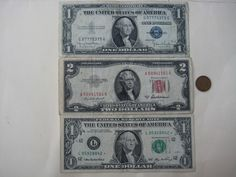 $2 and $5 Red Seal United States Currency Circulated Notes in a Plastic Folder