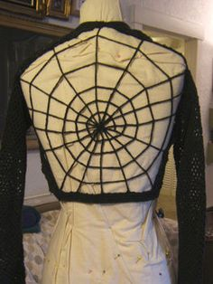 Spider web sweater made from a crochet sweater.