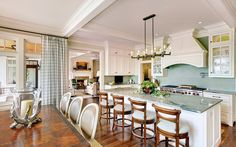 Eat in Kitchen- white with sea foam green subway tiles.  Private residence on Kiawah Island, SC- R.M. Buck Builders, Inc.