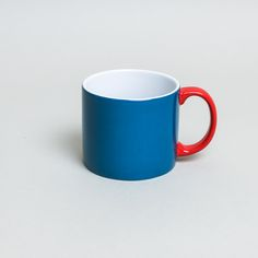 Serax International Jansen And Company Blue My Mug: Colourblock ceramic mug in blue with a red handle, designed by Anouk Jansen of Jansen & Company. A classic, simple shape, My Mug is also available in jade green or yellow - mix and match for a contemporary look. Gift boxed. Other co-ordinating products are also available.
