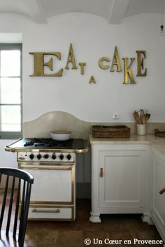 A Heart in Provence. French country kitchen with cute sign.