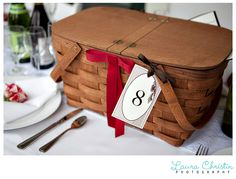 """GENIUS money saver. At each reception table was a picnic basket filled with cheese, crackers, baguettes, olives, and more goodies for the table to share. Catering by Whole Foods."""""""