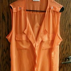 Orange Sheer Sleeveless Plus Size Brooks Top     Cute look to it with a comfortable loose feel. Slightly sheer so either a Tank top, or cute bandeau bra would be advised! :)      Bobbie Brooks Tops Blouses