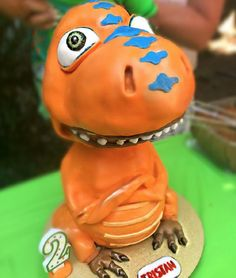 Dinosaur Train Birthday Cake Topper made with Satin Ice | Cake Sculptures Dinosaur Train, Dinosaur Birthday, Dino Cake, Birthday Cake Toppers, Sculptures, Christmas Ornaments, Holiday Decor, Party, Christmas Jewelry