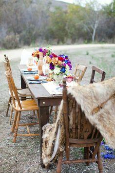 countryside, field, fur, vintage, wood, vibrant florals, bright colors, purple, blues, oranges, european, boho, eclectic.  Lauren Sharon Vintage Rentals and Design