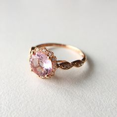 This blue diamond engagement ring makes an amazing gift for the woman in your life. It features a white gold ring and diamonds encrusted leaves with blue diamond center. This rose engagement ring is the perfect balance of style and grace. Rose Gold Morganite Ring, Rose Gold Diamond Ring, Pink Ring, Rose Gold Engagement Ring, Vintage Engagement Rings, Diamond Wedding Bands, Morganite Engagement, Wedding Rings, Pink Stone Rings