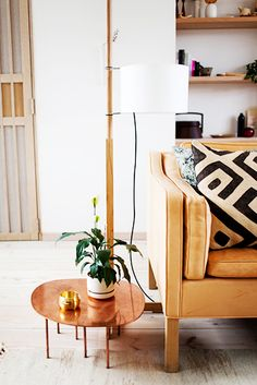 Love kuba cloth: So graphic.  The ochre colored sofa and plants:  Floating shelves in the background.  Just my style