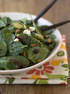 Baby spinach leaves are adorned with sun-dried tomatoes, cranberries, pine nuts and avocado and then tossed with a fresh balsamic-lime dressing.