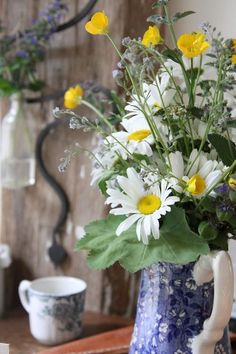 Wildflower arrangement in a pitcher - a great idea to add beauty to your home with flowers growing wild!
