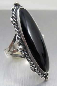 Listed is a gorgeous large knuckle size vintage Sterling Silver and Black Onyx Ring.    Ring is Marquis shaped with beautiful Sterling Silver