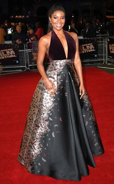 Darling Details from Fashion Police  Gabrielle Union wows in a burgundy Zuhair Murad gown with metallic details at The Birth of a Nation's London premiere. The dress is pretty and certainly fall-appropriate, but it wouldn't be nearly as striking without those gilded little butterflies on the skirt.
