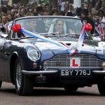 Prince William and Catherine, Duchess Cambridge driving the Ashton Martin DB6 Volonte Mk ll convertible.
