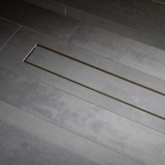A whole new look for water drainage in a tiled shower floor…