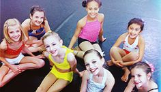 Paige(red shirt) , Brook(blue shirt), Nia(pink shirt), Vi-Vi Anne(white shirt), Chloe(yellow outfit), Maddie next to Chloe, and Mackenzie in the corner