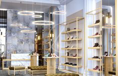 Simple yet luxurious shoe store design by Comelite Architecture Structure and Interior Design, white, taupe and gray as the main color scheme, with accents of gold in the shoe racks, in stool legs and display tables, adding richness to the store's interior. Gray marble wall with golden grouts contrasted by the white Carrara marble counter, and floor to ceiling mirrors extend the interior views.
