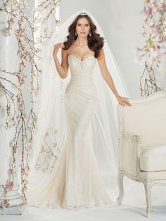 Wedding Dresses 2014 Collection – Simultaneously angelic and sensual, slimming side draped lace A-line gown Roslin is simply elegant. Delicate hand-beading highlights the strapless sweetheart neckline while a matching beaded brooch adorns the side hip. A sweep train and back corset closure complete the gown. Sizes: 0 – 22  Absolutely need to try this dress on.