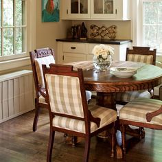 Patterned seating brings a subtle uniqueness to this cottage's breakfast room, and the gingham upholstery adds another dose of classic charm.