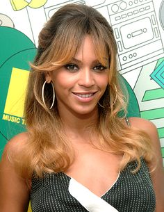 "Beyoncé's Hair Evolution: July 12, 2006 The ""Deja Vu"" singer kept it casual with side-swept bangs and subtle layers during an appearance on MTV's TRL in NYC."