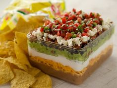 Get Eight-Layer Dip Recipe from Food Network