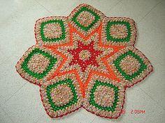 i saw a picture of a rug and loved that. i thought to make one like that. the original one was made with five colors and i could not get the idea how much yarn will it need and neither i got the pattern. so i thought to give it a try using my scrap yarn. the result is this one. it is not like the original but it is looking great.