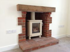 rebuild fireplace. The fireplace was installed by the builder when they did a very clever  rebuild of local farmhouse Here is recent installation Hagley Stoves Town and Country