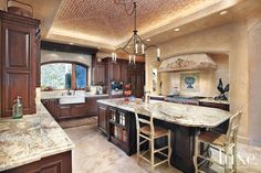 #Granite tops the counters in an Arizona #desert home's #kitchen. See more at www.luxesource.com. #luxe #luxemag #luxury #design #interiordesign #interiors #home #house #dwelling #residential #decor #homedecor #interiordecorating #interiordesignideas #architecture #cabinetry