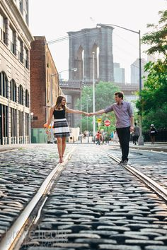 Plymouth street in DUMBO - brooklyn bridge train tracks engagement photos