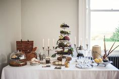 A rustic styled shoot with green foliage and feathers | wedding dessert tables | www.weddingsite.co.uk