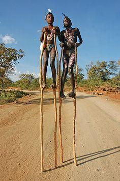 Kids on stilts by The Hoseman., via Flickr