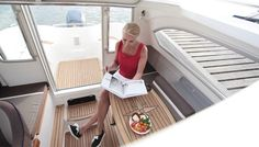 With the Yamarin 68 Cabin, you can begin the boating season right after the thaw and continue until the water freezes, travelling comfortably inside the cabin. Boater, Power Boats, Bath Caddy, Ds, Cabin, Motor Boats, Cottage, Cabins, Wooden Houses