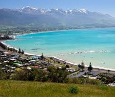 Kaikoura (New Zealand). I've been there numerous times. Anywhere in New Zealand, particularly the South Island has spectacular, breathtaking scenery!