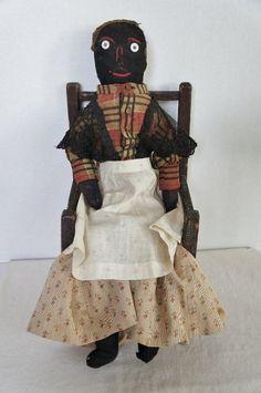 19th C. Black cloth doll with original clothes