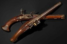 A pair of significant silver-mounted flintlock pistols by Ivan Permiak in St. Petersburg, circa 1770.
